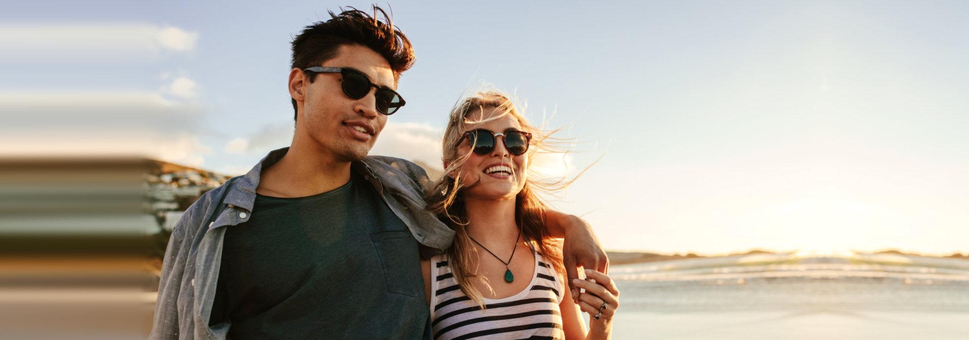 Young couple enjoying a summer day on seashore